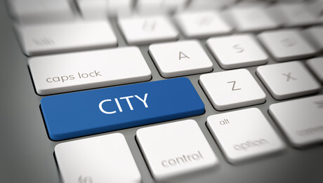 Online or internet concept with white text - CITY - on a blue enter key on a white computer keyboard viewed at an oblique high angle with blur vignette for focus. 3d Rendering.